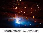 artistic welding sparks light ... | Shutterstock . vector #670990384