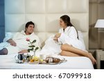 Stock photo relaxed couple in bed hotel room 67099918