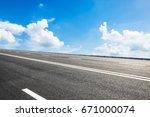 asphalt road and sky cloud...   Shutterstock . vector #671000074
