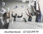 business team throwing paper... | Shutterstock . vector #671019979