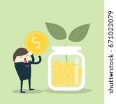 investor hold money with coin... | Shutterstock .eps vector #671022079