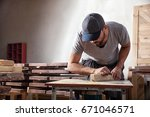 a young man in a gray cap... | Shutterstock . vector #671046571
