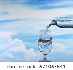 a glass of water  being poured... | Shutterstock . vector #671067841