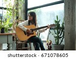 young asia woman using classic... | Shutterstock . vector #671078605