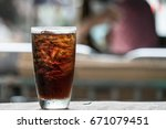 cola in glass background blur | Shutterstock . vector #671079451