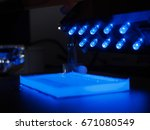Small photo of DNA analysis on Agarose gel electrophoresis are visualizing by UV light in molecular laboratory.