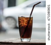 cola in glass background blur | Shutterstock . vector #671080801
