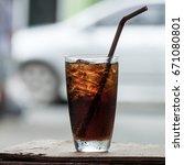 cola in glass background blur | Shutterstock . vector #671080801