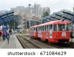 old tram on stop blur background | Shutterstock . vector #671084629
