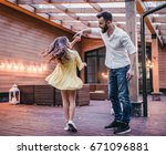 dad is dancing with his... | Shutterstock . vector #671096881