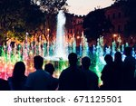 people looking at fountain and... | Shutterstock . vector #671125501