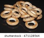 sushki on the black specular... | Shutterstock . vector #671128564