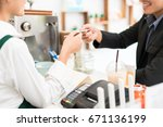 barista is making coffee at his ... | Shutterstock . vector #671136199