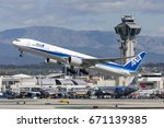 Small photo of Los Angeles, California, USA - March 10, 2010: All Nippon Airways (ANA) Boeing 777 aircraft taking off from Los Angeles International Airport.
