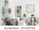 sad disabled senior man... | Shutterstock . vector #671149735