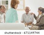 group of happy seniors sitting... | Shutterstock . vector #671149744