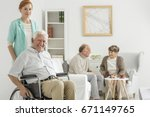 elder happy man sitting in... | Shutterstock . vector #671149765