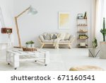 white blanket lying on bright... | Shutterstock . vector #671160541