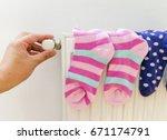 multicolored socks drying on...   Shutterstock . vector #671174791