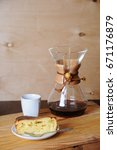 Small photo of Curd cake and alternate coffee brewing with filter. Rustic background, white cup
