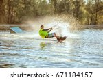 guy rushes along the lake on... | Shutterstock . vector #671184157