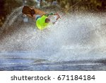 man is among a splash of water  ... | Shutterstock . vector #671184184