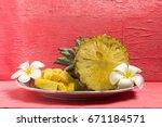 Pineapple On Dish Half With...