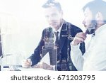two young entrepreneurs are...   Shutterstock . vector #671203795