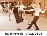 young smiling people practicing ... | Shutterstock . vector #671212585