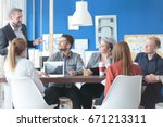 team of young employees eagerly ... | Shutterstock . vector #671213311