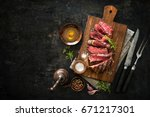 sliced medium rare grilled beef ... | Shutterstock . vector #671217301