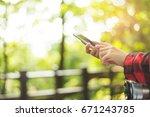 closeup of woman hands using... | Shutterstock . vector #671243785