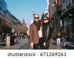 beautiful  young couple walking ... | Shutterstock . vector #671269261