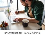 busy serious man in work | Shutterstock . vector #671272441