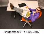 fast meal in office   man... | Shutterstock . vector #671282287