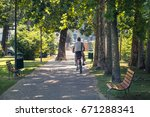 man riding a bike at park  old...   Shutterstock . vector #671288341
