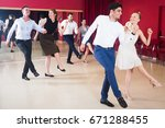 young smiling people practicing ... | Shutterstock . vector #671288455