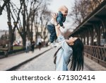 young mother with her baby boy... | Shutterstock . vector #671302414