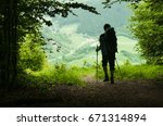 man with backpack hiking in... | Shutterstock . vector #671314894