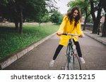 Cycling In The Rain. Cheerful...
