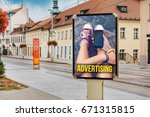 Small photo of Billboard with advertising of a teenage girl with cellphone. At city street of Bratislava, while passing the tram, Slovakia