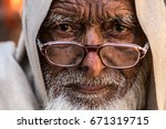 portrait of a rajasthani old... | Shutterstock . vector #671319715