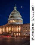Stock photo the us capitol at night with moon shining up above light painting 671321854