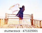 happy asian girl relax on view... | Shutterstock . vector #671325001