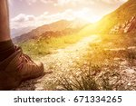 Hiker Walking On Mountain Path.