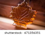 maple syrup  bottled in the... | Shutterstock . vector #671356351
