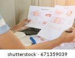 businessman analysis comparing... | Shutterstock . vector #671359039