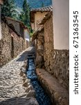 Small photo of Ollantaytambo is a village in the Sacred Valley of south Peru. The village's old town is an Inca-era grid of cobblestoned streets and adobe buildings.