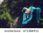 asian woman wearing a raincoat... | Shutterstock . vector #671386921