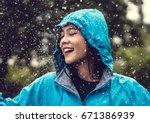 asian woman wearing a raincoat... | Shutterstock . vector #671386939